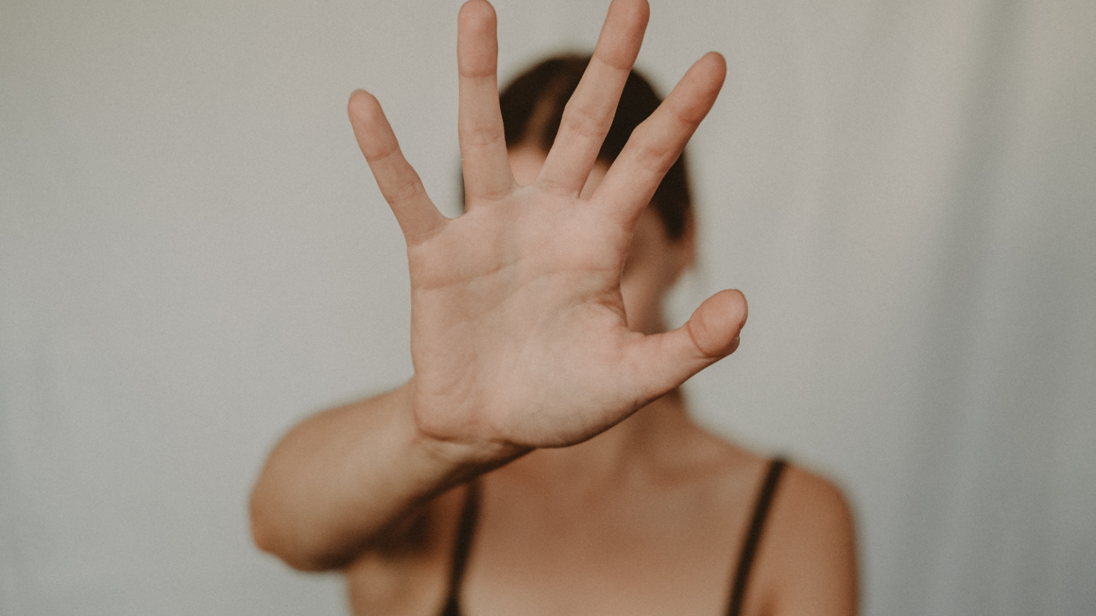white woman's hand up to the screen palm facing out, covering her face, illustration Have you considered adoption if this doesn't workt fertility now article