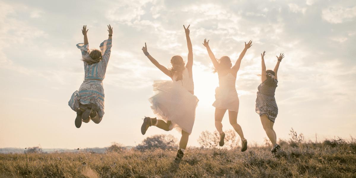 four women juping in the air in celebration, illustratiung dear hopeful ivf friend