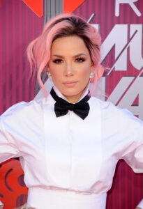 Halsey in a white shirt and black bow tie