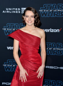 Daisy Ridley in a red dress