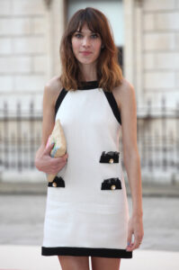Alexa Chung in a white and black dress, illustrating Celebrities with endometriosis